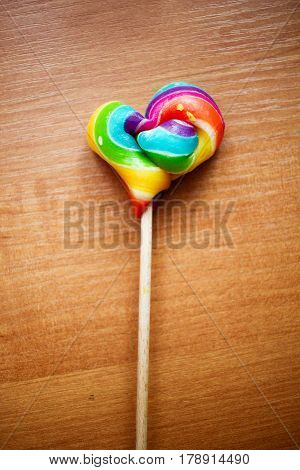 Colorful Rainbow Red Purple Yellow Blue Green Colors: Lolipop In A Shape Of Heart On A Stick On Wood