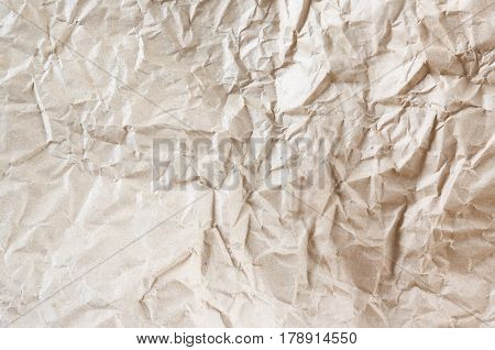 An abstract texture of rumpled packaging paper.