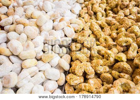 Background of typical sicilian cookiespastries made with almond paste for sale in italian market.