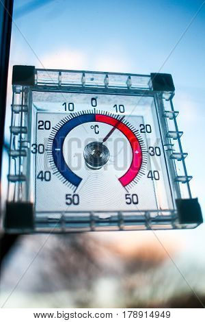 Close Up Focus On Old Analog Thermometer Showing 10 Degrees Above Zero. It Is Getting Warmer, Spring