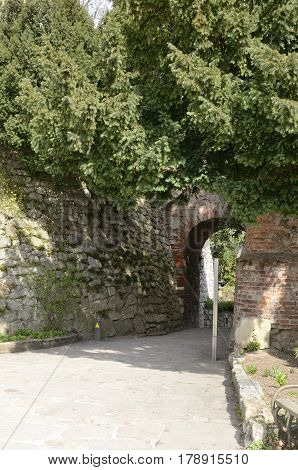 Brick arch in footpath at the hill Schlossberg in Graz the capital of federal state of Styria Austria.