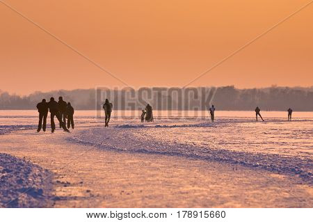 Ice Skaters On A Frozen Lake