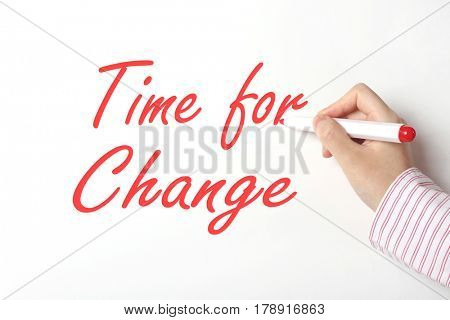 Business woman writing time for change word on whiteboard