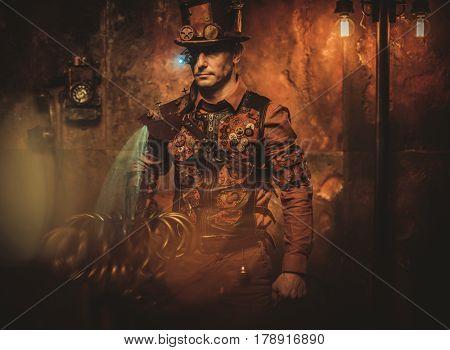 Steampunk man on vintage steampunk background