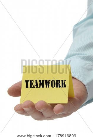 Business man holding yellow teamwork sign on hand