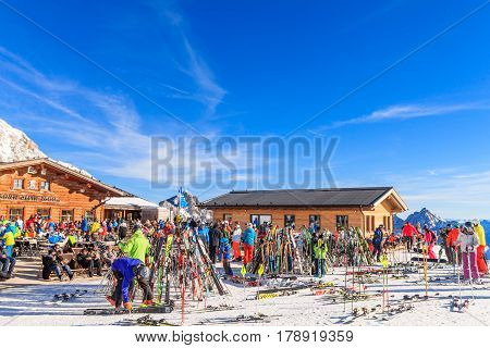 GARMISCH-PARTENKIRCHEN GERMANY - DECEMBER 10 2016: Unidentified tourists at Zugspitze Glacier Ski Resort in Bavarian Alps on Top of Germany Zugspitze in Garmisch Partenkirchen Germany