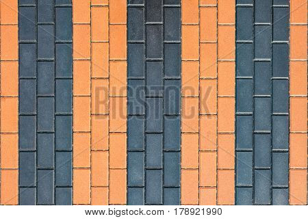 Pavement in the form of St. George ribbon. Background with tiled.