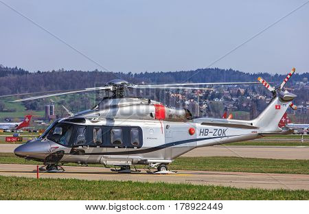 Kloten, Switzerland - 29 March, 2017: an AgustaWestland AW 139 helicopter in the Zurich Airport. The AgustaWestland AW139 is a 15-seat medium-sized twin-engine helicopter developed and produced by AgustaWestland company.