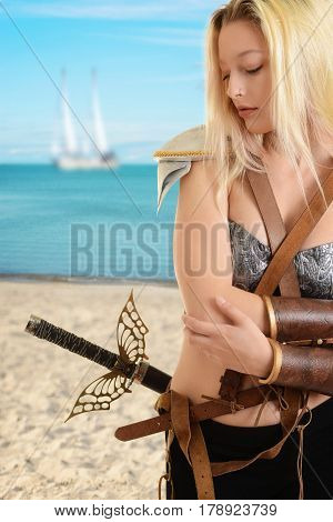 woman warrior at the beach with ship in background