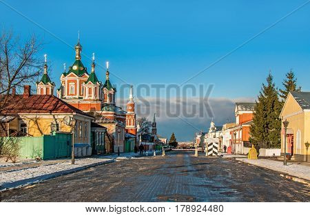 Kolomna Brusensky monastery in the early morning in the spring with the reflection of the sky in the puddles