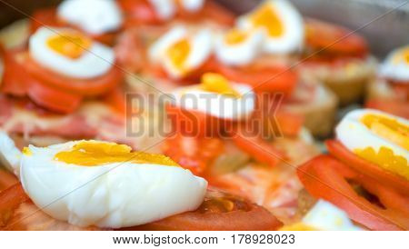 Colorful sandwich with margarine, pickles, cheese, tomato and boiled eggs