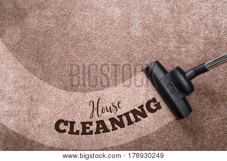 Vacuuming carpet with vacuum cleaner. House cleaning. Housework service. Close up of the head of a sweeper cleaning device. poster