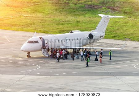 Passengers board an airplane before departure at the airport. Russia, Ekaterinburg, July 2015