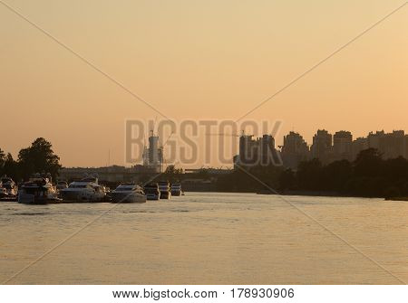 View of Neva river on the outskirts of St. Petersburg at sunset Russia.