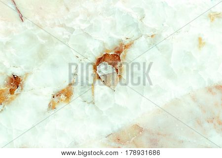 Close-up crushed marble stone texture background, Detailed real genuine marble structure from nature, Can be used for creating a marble surface effect to your designs or images.