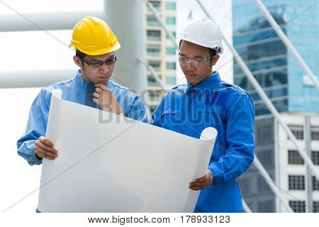 Two Engineer Or Architect Discuss