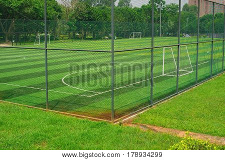 a soccer field behind the fence horizontal composition