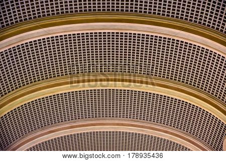 Architectural background. A modern white concrete arched ceiling in perspective. The same semicircular shapes