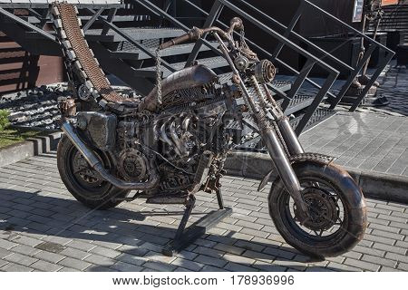 ZELENOGRADSK (KALININGRAD REGION), RUSSIA - MAR 21, 2017: decorative motorcycle, handcrafted made of metal near the entrance to the restaurant in the city centre