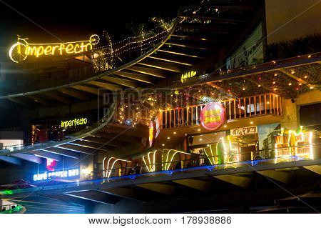 Noida, India - 19th Mar 2017: night lights at Garden Galleria mall in Delhi showing imperfecto and Laat Sahib