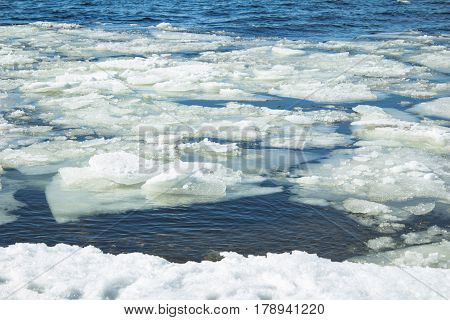 lots of ice floes floating in the river