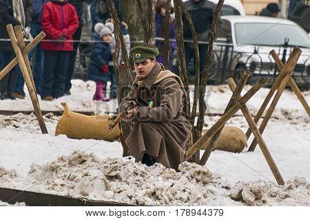 Lviv Ukraine - January 29 2017: Military historical reconstruction battle of Kruty . Gunner defending position during reconstruction Lviv Ukraine.