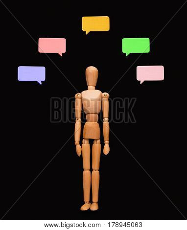 Handcrafted wooden man with blank speech bubble, presenting creative idea or business solution on black studio background, copy space, objects, nobody