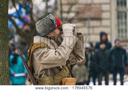 Lviv Ukraine - January 29 2017: Military historical reconstruction battle of Kruty .Сommander of the Red Army is watching the battle Lviv Ukraine.