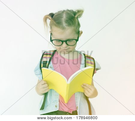 Little bookworm girl reading the book for knowledge