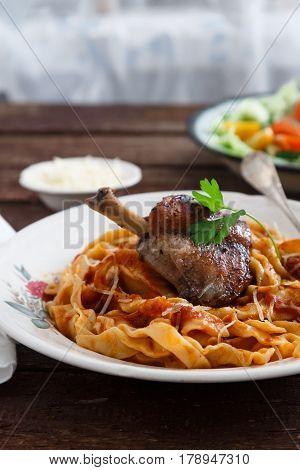 Italian pasta plate Tagliatelle with rabbit ragout, close view.