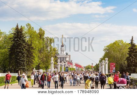 MOSCOW - MAY 8 2016: People walking on the main alley of VDNKh park complex. This place was developed in soviet times as an Exhibition of Achievements of National Economy.