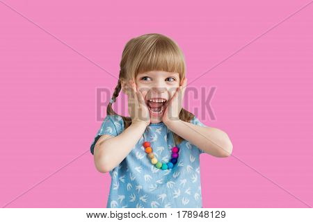 Little girl smiling at the background in the studio