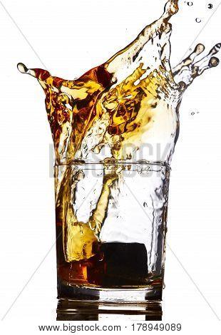 splash of whiskey isolated on white.Concept alcohol splash