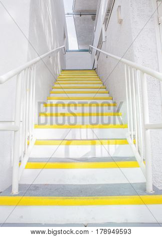Outdoor Concrete Staircase With white Steel Handrail