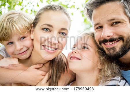 Portrait of happy family in harmony with each other in summer