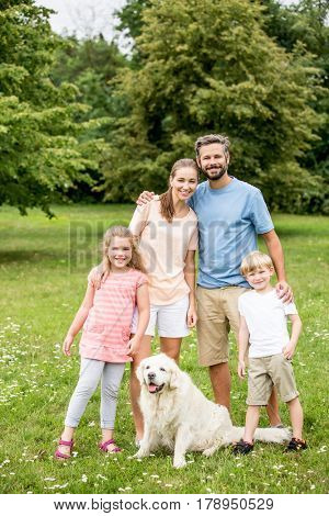 Portrait of lucky and happy family together at garden in summer