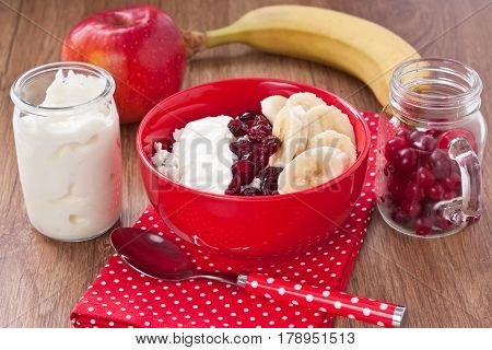 Cottage cheese with banana yogurt dried cranberry and apple for healthy breakfast