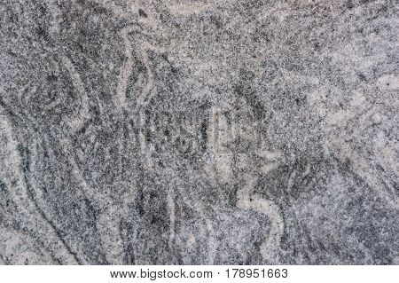 Closeup of grey polished granite textured background