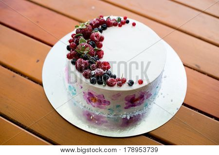 Fresh berries on the tart cake from above. Selective focus on the tart