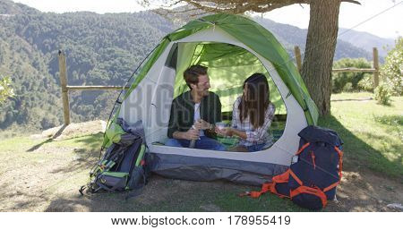 Two people having rest in tent
