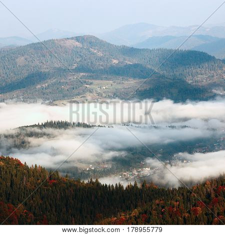 colorful foggy autumn Carpathians landscape, location west ukraine,   sunrise in Ukrainian Carpathian mountains, east Europe, wonderful world