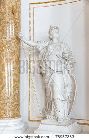 Symbols in arts - statue of Athena. Marble.