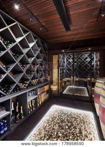 luxury cellar of prestigious house, shelves full of bottles