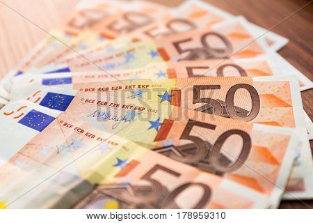 Fifty euro banknotes on the desk