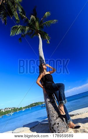 Asian Girl Standing With Palms Tree