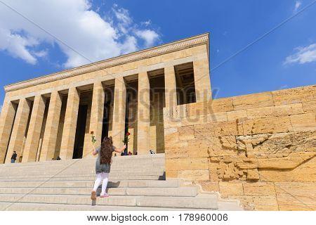 Ankara, Turkey - March 27, 2017: Little girl runs toward the Mausoleum of Ataturk in Ankara, Turkey