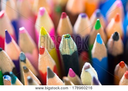 Stack of different various vibrant color pencils as creativity imagination possibility education creative school concept background