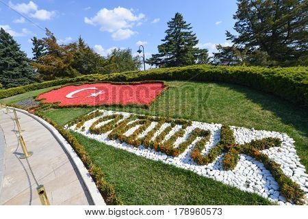 Ankara, Turkey - March 27, 2017:Turkish flag and signature of Ataturk designed on the grass at Mausoleum of Ataturk - Ankara, Turkey