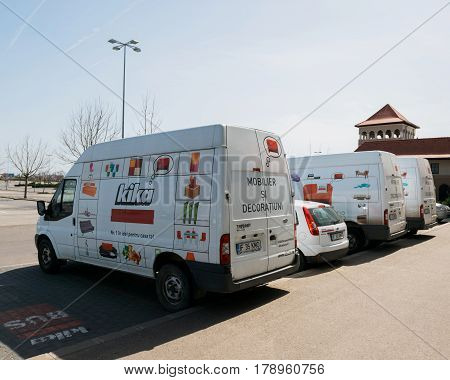 BUCHAREST ROMANIA - APR 1 2016: Furniture delivery vans in a row with KIKA store advertising and logotype. Kika is an international chain of furniture stores headquartered in Austria
