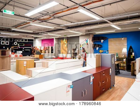 BUCHAREST ROMANIA - APR 1 2016: Woman buying wardrobe cabinet storage and interior furniture at the KIKA store selling ready-to-assemble furniture kitchen appliances and home accessories